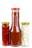 Jars with marinated piquant vegetables — Stock Photo