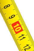 Close-up shot of yellow metal measurement tape — Stock Photo