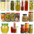 Set of different berries, mushrooms and vegetables conserved in glass jars — Stock Photo #3297720