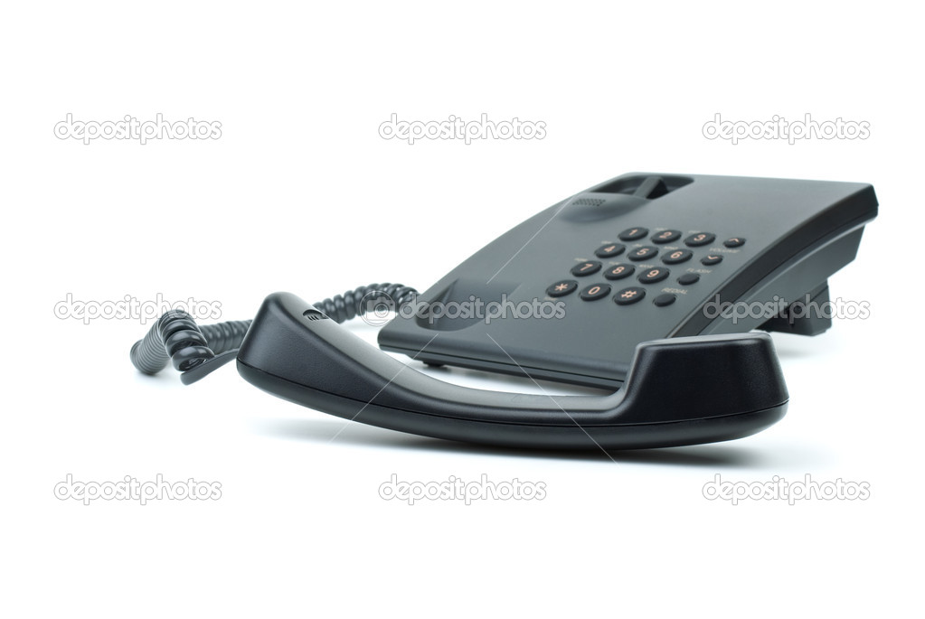 Black office phone with handset on foreground isolated in the white background  Stock Photo #3297842