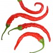 Four crooked red hot chili peppers — Stock Photo