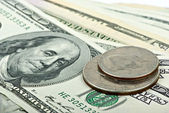 Few 100$ banknotes and two coins — Stock Photo
