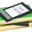 Ebook reader and traditional paper books — Stock Photo