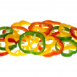 Red, yellow and green bell pepper slices - Stock Photo
