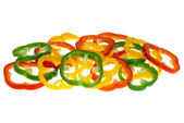 Red, yellow and green bell pepper slices — Stock Photo