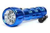 Blue metal LED flashlight — Stock Photo
