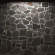 Illuminated stone wall - Stock Photo