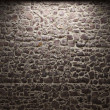 Illuminated stone wall - Stock fotografie