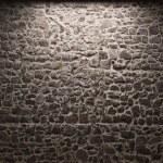 Illuminated stone wall — Stock Photo #2804681