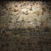 Освещенная каменная стена — Стоковое фото