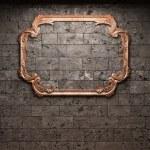 Illuminated brick wall and mirror — Stock Photo
