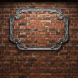 Illuminated brick wall and mirror — Stock Photo