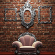 Stock Photo: Illuminated brick wall and chair