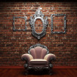 Illuminated brick wall and chair - Foto Stock