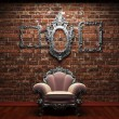 Illuminated brick wall and chair - Stockfoto