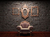 Illuminated stone wall and chair — Stock Photo