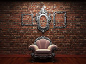 Illuminated brick wall and chair — Stock Photo