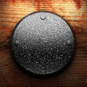 Iron plate on wood — Stock Photo