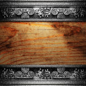 Iron ornament on wood made in 3D — Stock Photo