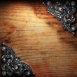 Royalty-Free Stock Photo: Iron ornament on wood made in 3D