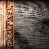Zlatý ornament na dřevo — Stock fotografie
