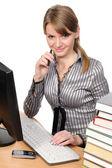 Woman in front of her desktop computer — Stock Photo