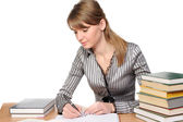 Businesswoman with books on table — Stock Photo