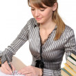 Stock Photo: Businesswoman with books on table