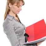 Businesswoman holding a planner/folder — Stock Photo #3038843