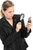 Using magnifying glass — Stock Photo
