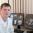 Doctor with CT scan films — Stock Photo