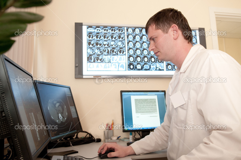 Computer tomography diagnostics, doctor working with films — Stock Photo #3579345