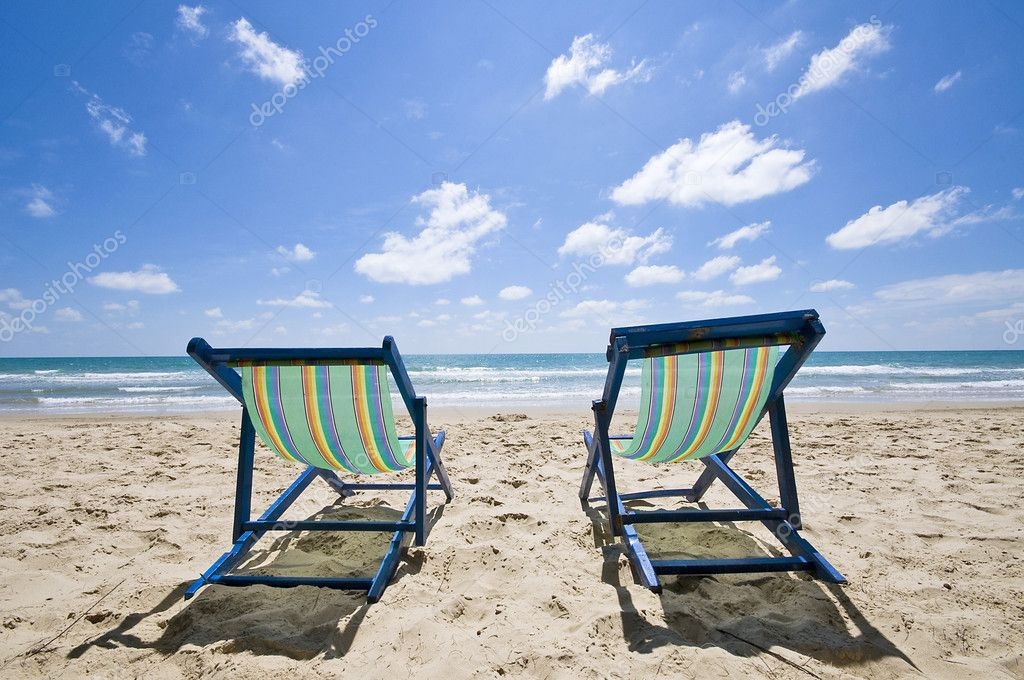 Two sunbeds on the beach with blue sky, Thailand — Stock Photo #3051934