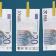 Stock Photo: Three Euro bills hanging on clothesline