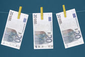 Three Euro bills hanging on clothesline — Stock Photo