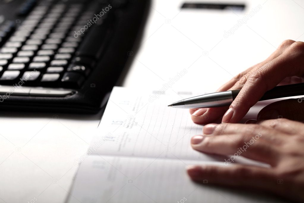 Woman writing to do list  Stock Photo #3045431