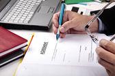 Businessman signing Agreement — Stock Photo