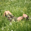 Stock Photo: Girl resting in meadow