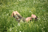 Girl resting in meadow — Stockfoto