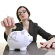 Woman putting coins in piggy bank — Stock Photo #2763341