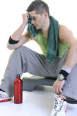 Sportsman relaxing and drinking water — Stock Photo