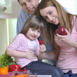 Happy young family in kitchen — 图库照片