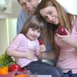 Happy young family in kitchen — Stock Photo #2830636