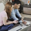 Young couple working on laptop at home — Stok fotoğraf #2845697
