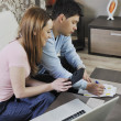 Young couple working on laptop at home — Stock Photo #2845697