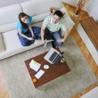 Young couple working on laptop at home — Foto de Stock