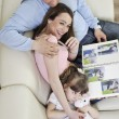 Happy family looking photos at home — Stock Photo #2845843