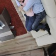 Couple relax at home on sofa — Stock Photo #2845951