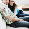 Couple relax at home on sofa — Stock Photo #2845955