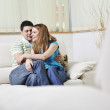 Couple relax at home on sofa — Stock Photo #2845961